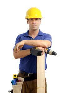 Construction contractor carpenter with drill on white